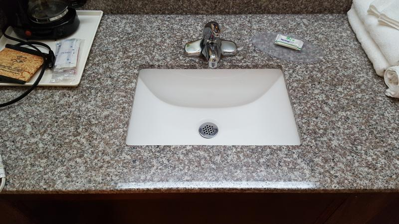 beige brown granite show with rect sink